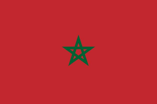 Marockos flagga. Helt röd med grön stjärna i mitten.