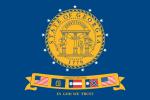 Blå flagga med gult runt märke i mitten och en banderoll med fem små flaggor under