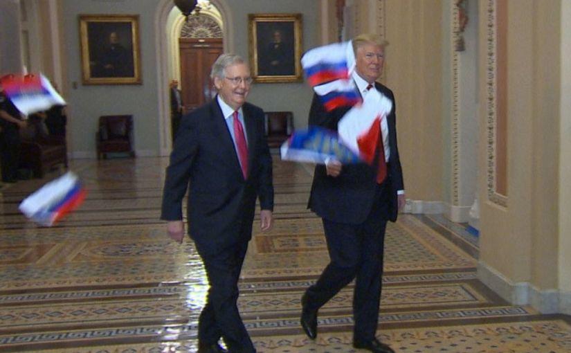 Ryska flaggor kastades påTrump